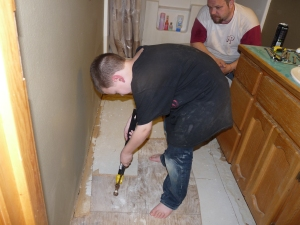 bathroom floor being ripped up
